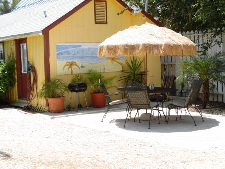 Click to enlarge image Good outdoor space for grilling and outdoor cookouts. - YELLOW FIN COTTAGE - Great beach cottage in a small package. Comfy queen bed, futon, partial kitchen, bath, walk to beach. Dog friendly. 2-3 persons.