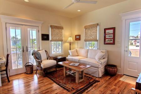 Click to enlarge image Gleaming red oak floors, showcase the comfortable furniture. - SEA OATS COTTAGE - Gracious getaway for two!!