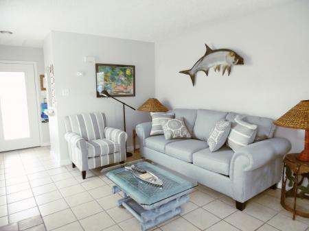 Click to enlarge image Newly remodeled living room - Tarpon Quarters - One bedroom, with king bed, one bath. LARGE condo with laundry, tile floors, Dog Friendly.Walk to the beach.