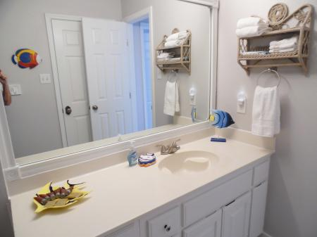 Click to enlarge image Sparkly new bathroom - Tarpon Quarters - One bedroom, with king bed, one bath. LARGE condo with laundry, tile floors, Dog Friendly.Walk to the beach.