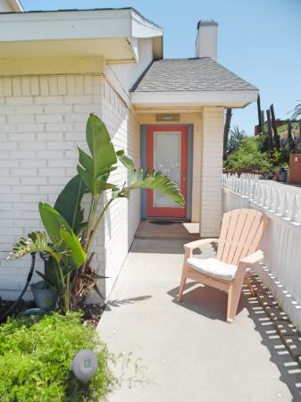Click to enlarge image Front entrance from the fenced yard - Tarpon Quarters - One bedroom, with king bed, one bath. LARGE condo with laundry, tile floors, Dog Friendly.Walk to the beach.