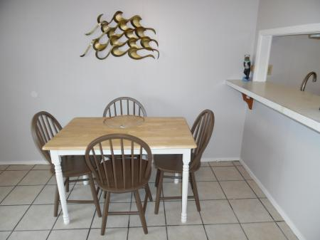 Click to enlarge image Dinner for 2 and guests - Mustang Isle #28 - One Bedroom Condo, Sleeps two, galley kitchen and queen bedroom.