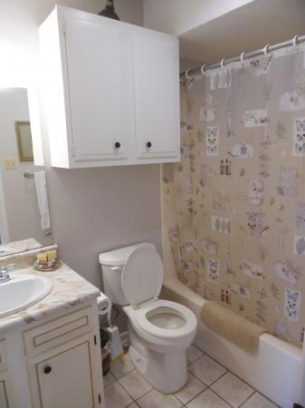 Click to enlarge image Tub and shower, more storage - Mustang Isle #28 - One Bedroom Condo, Sleeps two, galley kitchen and queen bedroom.