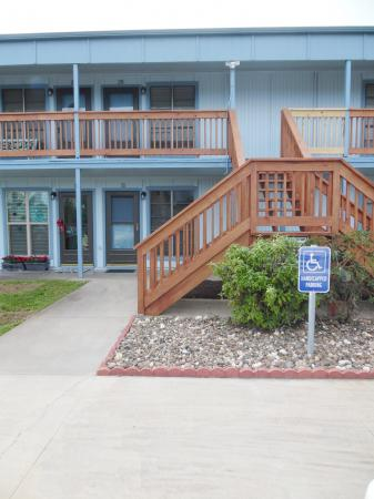 Click to enlarge image First unit at the top of the stairs - Mustang Isle #28 - One Bedroom Condo, Sleeps two, galley kitchen and queen bedroom.