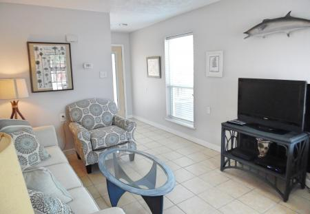 Click to enlarge image Tv and internet throughout the condo - Wahoo Quarters - One bedroom, one bath, LARGE condo with laundry, tile floors, Dog Friendly. Walk to beach