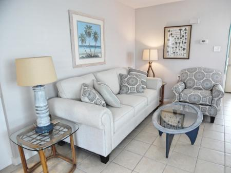 Click to enlarge image Comfy living room with queen sleeper - Wahoo Quarters - One bedroom, one bath, LARGE condo with laundry, tile floors, Dog Friendly. Walk to beach