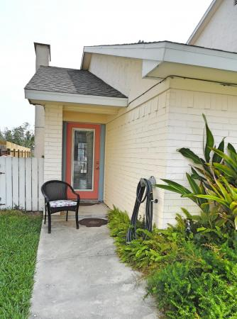 Click to enlarge image Front entrance from the large fenced yard - Wahoo Quarters - One bedroom, one bath, LARGE condo with laundry, tile floors, Dog Friendly. Walk to beach