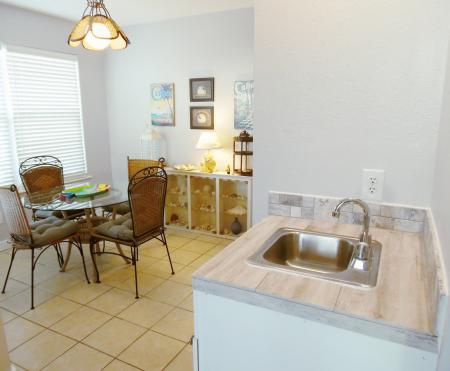 Click to enlarge image Wet bar between living and dining areas - Wahoo Quarters - One bedroom, one bath, LARGE condo with laundry, tile floors, Dog Friendly. Walk to beach