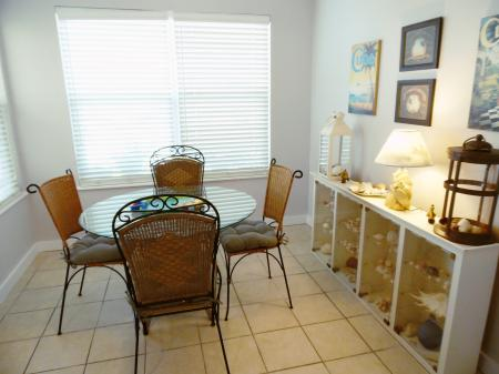 Click to enlarge image Dining room-check out the shell collection - Wahoo Quarters - One bedroom, one bath, LARGE condo with laundry, tile floors, Dog Friendly. Walk to beach