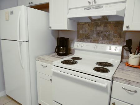 Click to enlarge image New appliances - Wahoo Quarters - One bedroom, one bath, LARGE condo with laundry, tile floors, Dog Friendly. Walk to beach