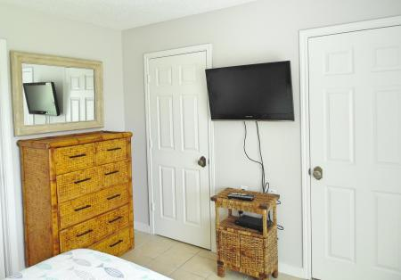 Click to enlarge image Tv and 2 large closets - Wahoo Quarters - One bedroom, one bath, LARGE condo with laundry, tile floors, Dog Friendly. Walk to beach