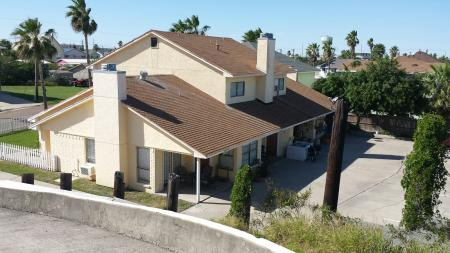Click to enlarge image The Coastal Quarters 4-plex. Wahoo is at the far end - Wahoo Quarters - One bedroom, one bath, LARGE condo with laundry, tile floors, Dog Friendly. Walk to beach