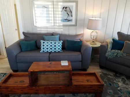 Click to enlarge image Bright living room with new furnishings - The Light House, Charming 2BR, Dog Friendly, Screened Porch - Private Home, Sleeps 6, Fenced Yard, Walk to shopping.