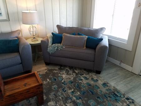 Click to enlarge image Oversized chair makes into a twin sleeper - The Light House, Charming 2BR, Dog Friendly, Screened Porch - Private Home, Sleeps 6, Fenced Yard, Walk to shopping.