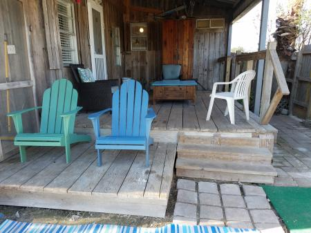 Click to enlarge image Back porch in private fenced yard - The Light House, Charming 2BR, Dog Friendly, Screened Porch - Private Home, Sleeps 6, Fenced Yard, Walk to shopping.