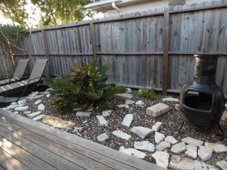 Click to enlarge image Rock garden and chiminea for cool nights - La Perla, Gorgeous remodel, 1 BR 1 BA Cottage, Fenced Yard, Backyard Oasis -